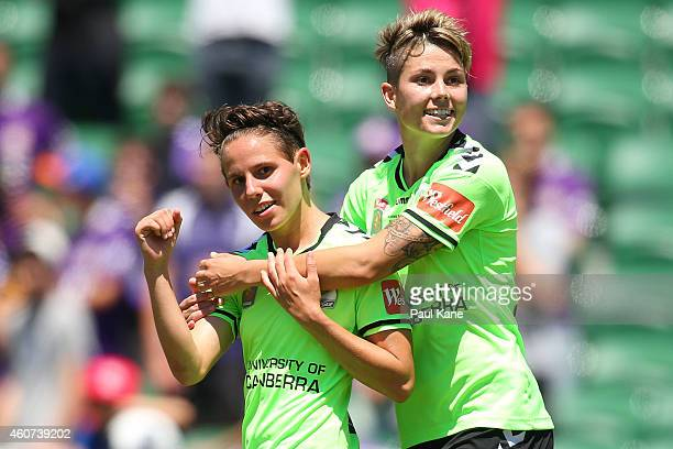 Ashleigh Sykes and Michelle Heyman of Canberra celebrate a goal during the WLeague Grand Final match between Perth and Canberra at nib Stadium on...