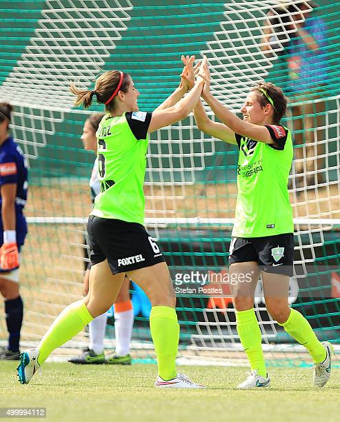 Ashleigh Sykes celebrates with Caitlin Munoz of Canberra United after scoring a goal during the round eight WLeague match between Canberra United and...