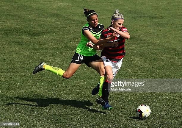 Ashleigh Sykes of Canberra and Caitlin Cooper of the Wanderers compete for the ball during the round 13 WLeague match between the Western Sydney...