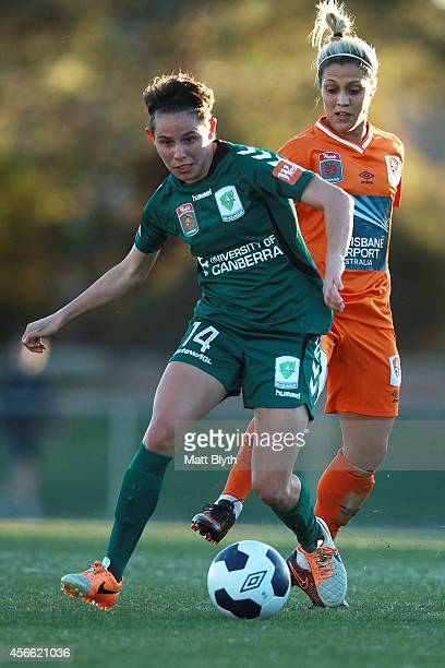 Ashleigh Sykes of Canberra and KatrinaLee Gorry of Brisbane compete for the ball during the round four WLeague match between Canberra United and...