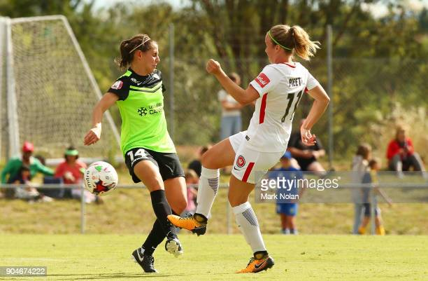 Ashleigh Sykes of Canberra and Marlous Pieete of the Wanderers contest possession during the round 11 WLeague match between Canberra United and the...