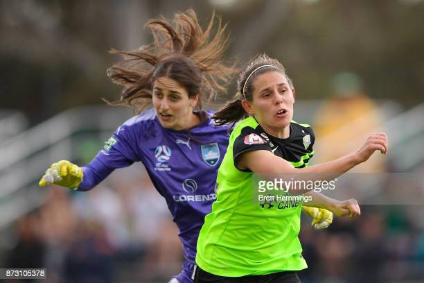 Ashleigh Sykes of Canberra collides with Shamiran Khamis of Sydney during the round three WLeague match between Canberra United and Sydney FC at...