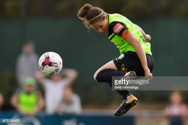 Ashleigh Sykes of Canberra heads a high ball during the round three WLeague match between Canberra United and Sydney FC at McKellar Park on November...