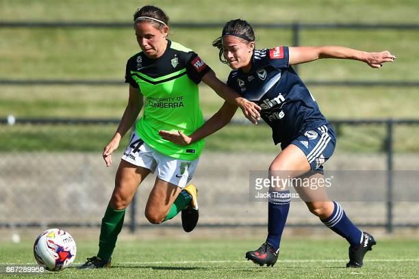 Ashleigh Sykes of Canberra runs with the ball during the round one WLeague match between Melbourne Victory and Canberra United at Epping Stadium on...