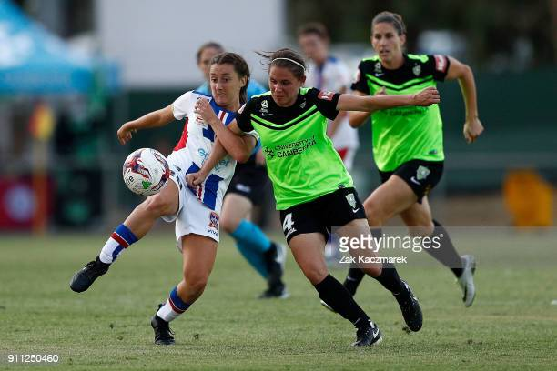 Ashleigh Sykes of Canberra United and Clare Wheeler of Newcastle Jets contest for the ball during the round 13 WLeague match between Canberra United...