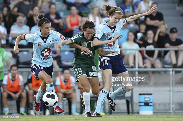 Ashleigh Sykes of Canberra United, Chloe Logarzo and Alesha Clifford of Sydney FC contest possession during the round three W-League match between...