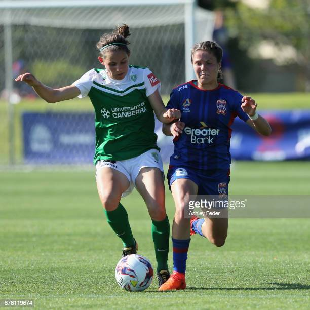 Ashleigh Sykes of Canberra United contests the ball against Sophie Nenadovic of the Jets during the round four WLeague match between Newcastle and...