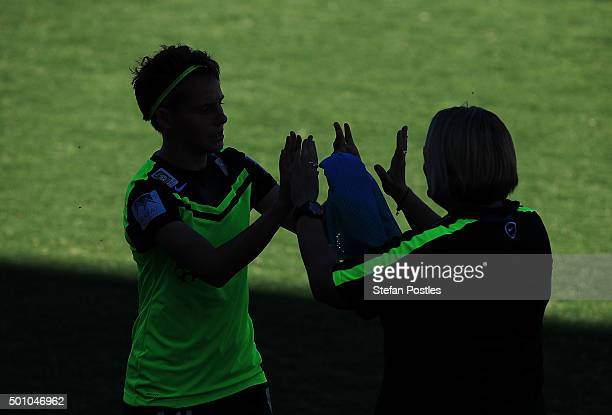 Ashleigh Sykes of Canberra United gets a high five from Head Coach Rae Dower during the round nine WLeague match between Canberra United and Adelaide...