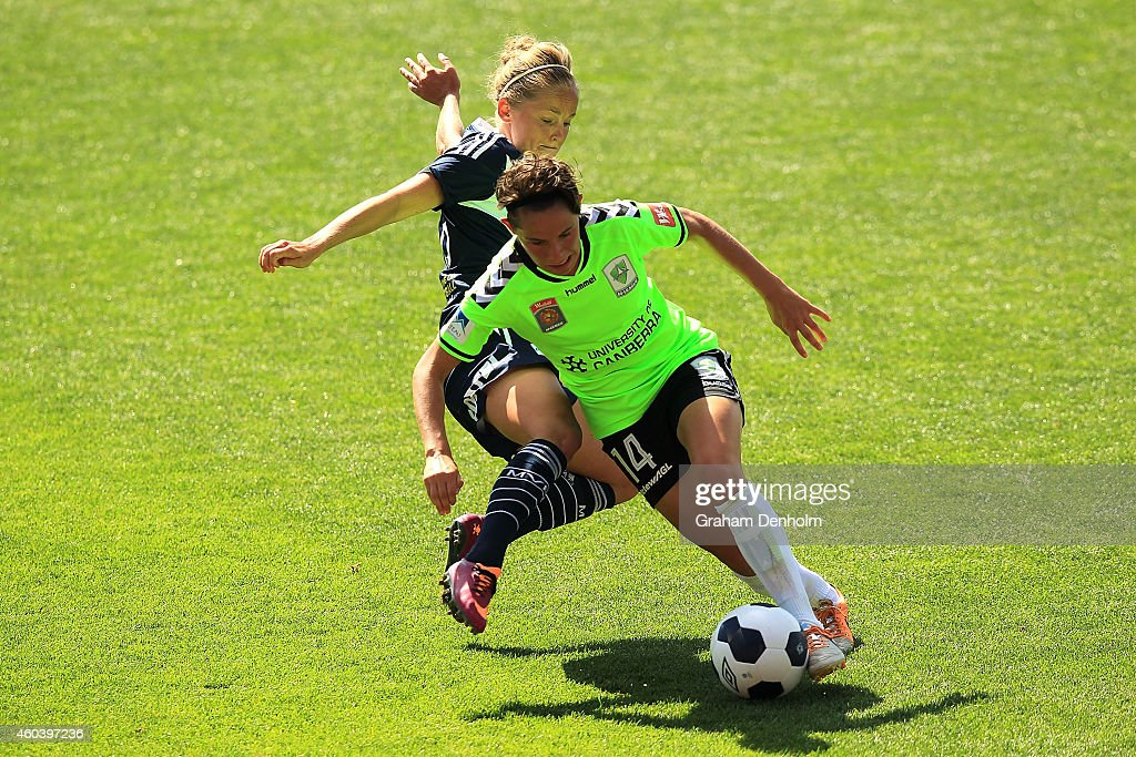 Ashleigh Sykes of United (R) controls the ball under pressure from Elli Reed of the Victory during the W-League Semi Final match between Melbourne Victory and Canberra United at Simonds Stadium on December 13, 2014 in Geelong, Australia.