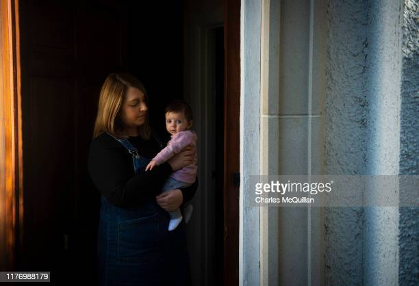 Ashleigh Topley stands in her doorway with four- month-old daughter Harper on October 18, 2019 in Portadown, Northern Ireland. In 2013 Ashleigh...