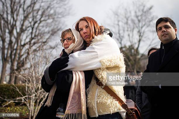 Ashley Agin right and her mother Lynn Austin wait in line outside of the Supreme Court to pays respects to the late Justice Antonin Scalia as he lies...