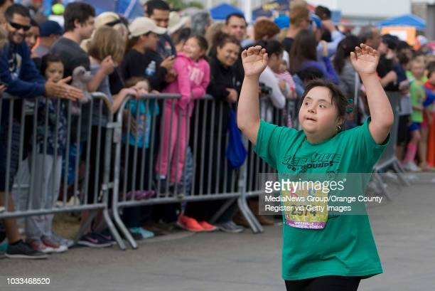Ashley Anaya celebrates her finish of the Kids Run the OC on Saturday ///ADDITIONAL INFO Photo by MINDY shot 043016 kidsrun0501 More than 8400 kids...