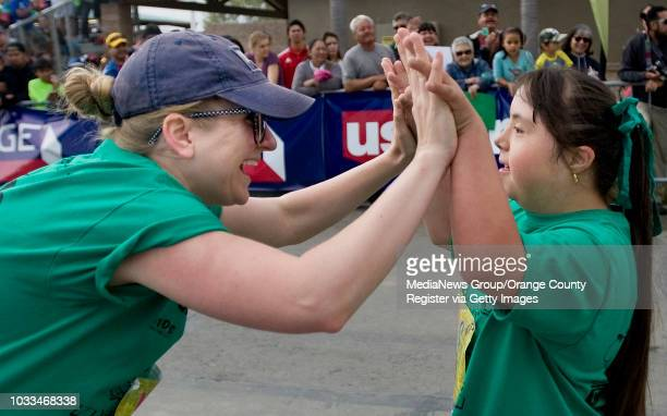Ashley Anaya is congratulated by her teacher Bethany Bohn after the Greenville Fundamental school student finishes the Kids Run the OC race on...