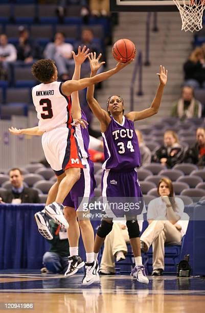 Ashley Awkward of Ole Miss shooting a layup over TCU's Ashley Davis in the first half of the firstround game at the Hartford Civic Center in Hartford...