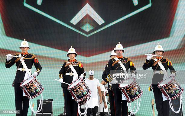 Ashley Banjo and Diversity with the Marine Band perform onstage during the Invictus Games Closing Concert at the Queen Elizabeth Olympic Park on...