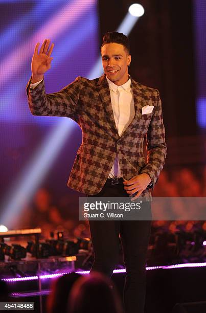 Ashley Banjo makes his way to the jedges panel during the first live show of 2014's 'Got To Dance' at Earls Court on August 25 2014 in London England