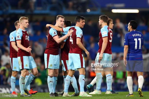 Ashley Barnes and Burnley team mates shake hands during the Premier League match between Chelsea FC and Burnley FC at Stamford Bridge on April 22...