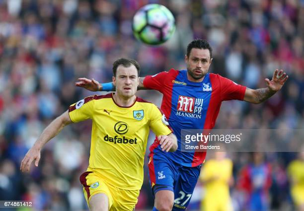 Ashley Barnes of Burnley and Damien Delaney of Crystal Palace chase the ball during the Premier League match between Crystal Palace and Burnley at...