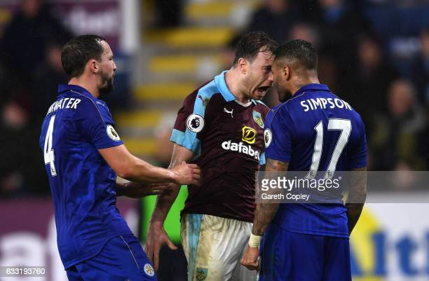 Ashley Barnes of Burnley and Danny Simpson of Leicester City square off while Danny Drinkwater of Leicester City tries to separate them during the...