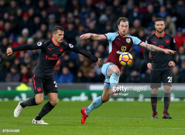 Ashley Barnes of Burnley and Granit Xhaka of Arsenal in action during the Premier League match between Burnley and Arsenal at Turf Moor on November...