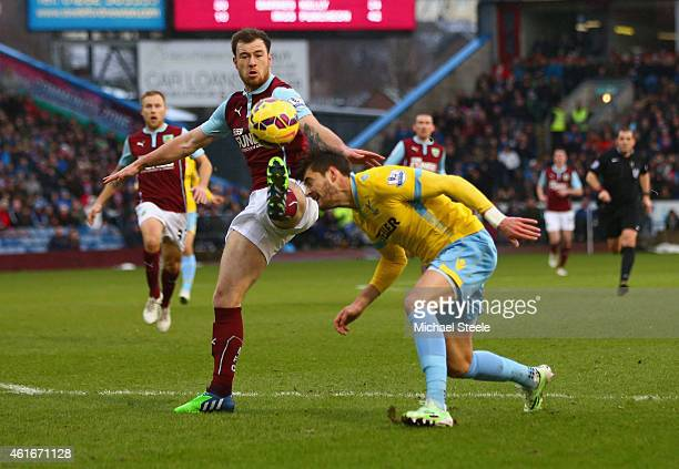 Ashley Barnes of Burnley and Joel Ward of Crystal Palace battle for the ball during the Barclays Premier League match between Burnley and Crystal...