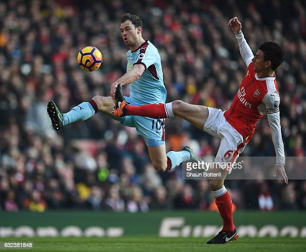 Ashley Barnes of Burnley and Laurent Koscielny of Arsenal compete for the ball during the Premier League match between Arsenal and Burnley at the...