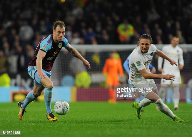 Ashley Barnes of Burnley and Luke Ayling of Leeds in action during the Carabao Cup Third Round match between Burnley and Leeds United at Turf Moor on...