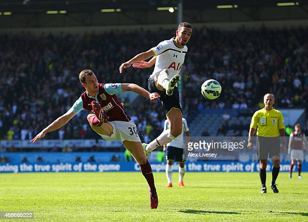 Ashley Barnes of Burnley and Nabil Bentaleb of Spurs battle for the ball during the Barclays Premier League match between Burnley and Tottenham...