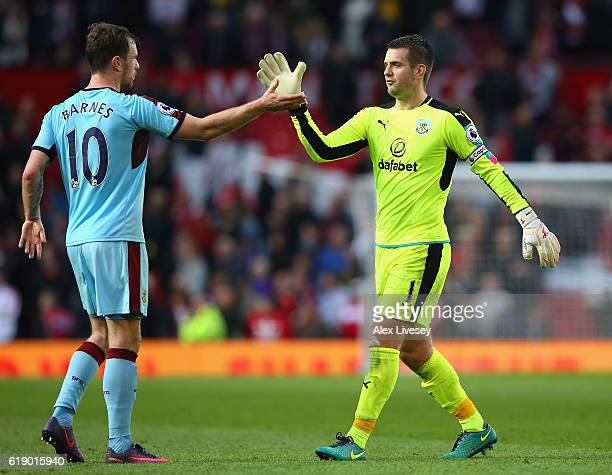 Ashley Barnes of Burnley and Thomas Heaton of Burnley shake hands after the final whistle during the Premier League match between Manchester United...