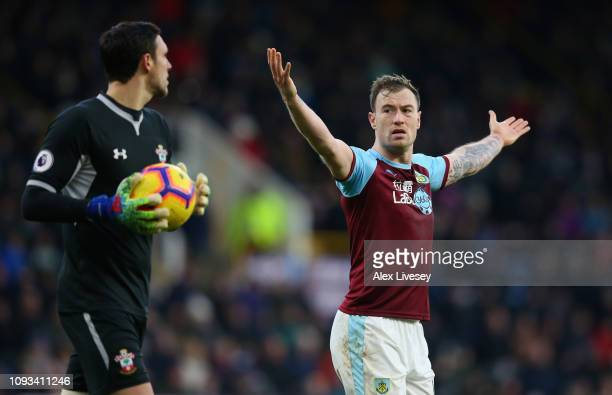 Ashley Barnes of Burnley appeals for Alex McCarthy of Southampton FC to take a kick during the Premier League match between Burnley FC and...