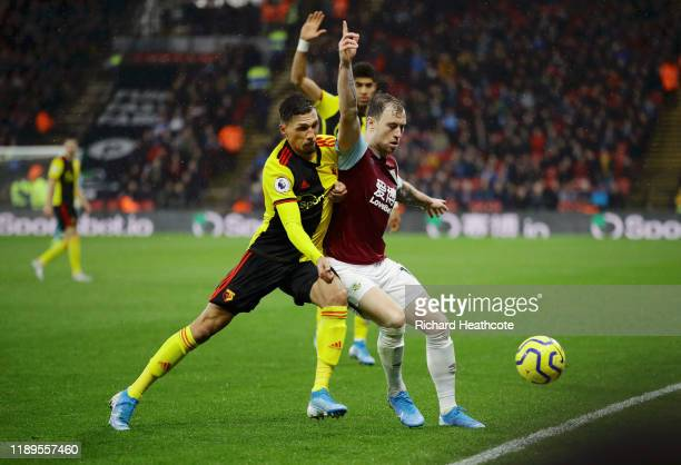 Ashley Barnes of Burnley battles for possession with Jose Holebas of Watford during the Premier League match between Watford FC and Burnley FC at...