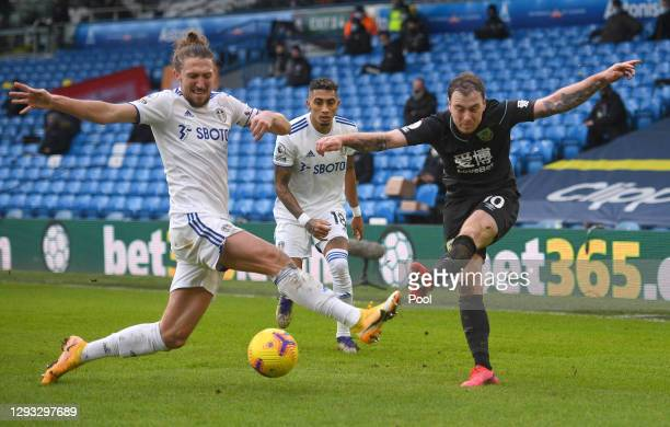 Ashley Barnes of Burnley battles for possession with Luke Ayling of Leeds United during the Premier League match between Leeds United and Burnley at...