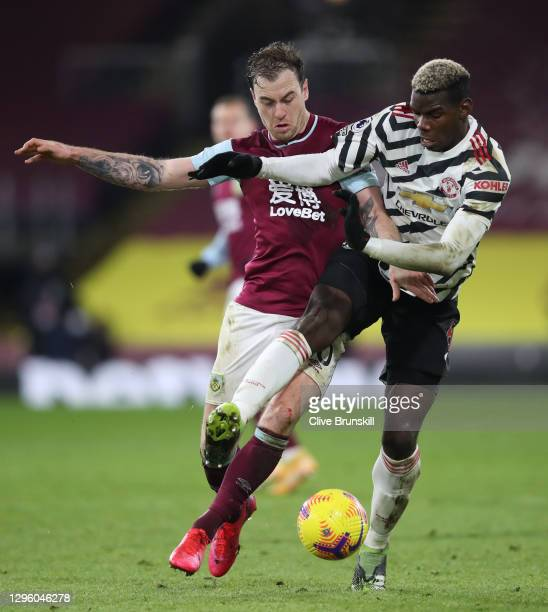 Ashley Barnes of Burnley battles for possession with Paul Pogba of Manchester United during the Premier League match between Burnley and Manchester...