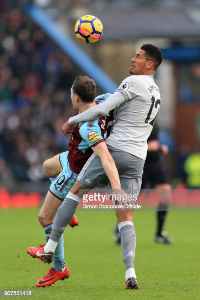 Ashley Barnes of Burnley battles with Chris Smalling of Man Utd during the Premier League match between Burnley and Manchester United at Turf Moor on...