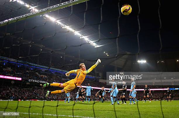 Ashley Barnes of Burnley beats Joe Hart of Manchester City to score the equalizing goal during the Barclays Premier League match between Manchester...