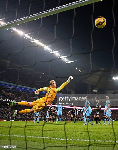 Ashley Barnes of Burnley beats Joe Hart of Manchester City to scpore the equalizing goal during the Barclays Premier League match between Manchester...