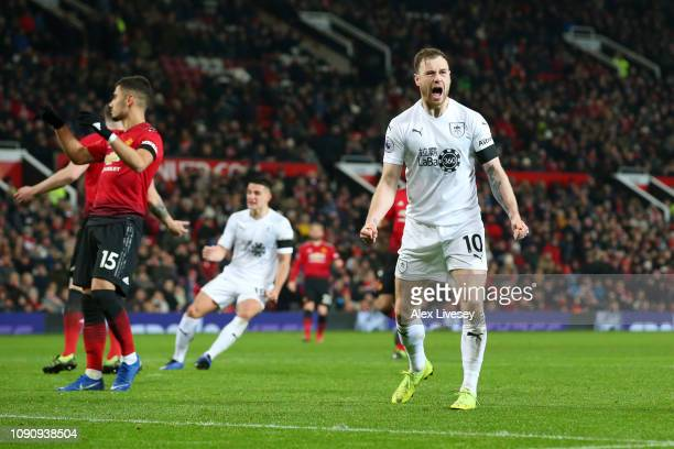 Ashley Barnes of Burnley celebrates after scoring his team's first goal during the Premier League match between Manchester United and Burnley at Old...