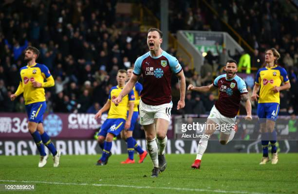 Ashley Barnes of Burnley celebrates after scoring his team's first goal from the penalty spot during the Premier League match between Burnley FC and...