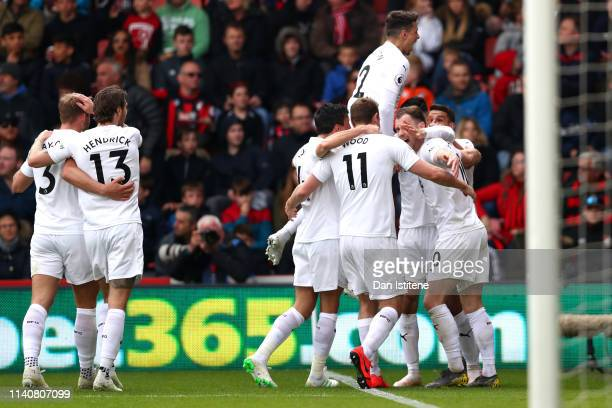 Ashley Barnes of Burnley celebrates after scoring his team's third goal with his team mates during the Premier League match between AFC Bournemouth...