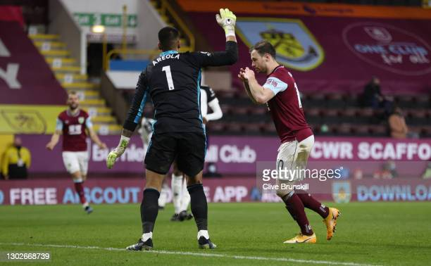 Ashley Barnes of Burnley celebrates after scoring their side's first goal past Alphonse Areola of Fulham during the Premier League match between...