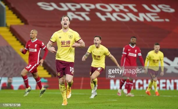 Ashley Barnes of Burnley celebrates after scoring their team's first goal from the penalty spot during the Premier League match between Liverpool and...