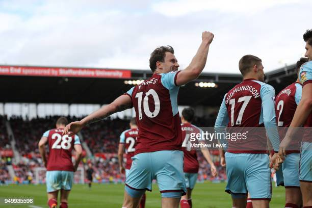 Ashley Barnes of Burnley celebrates scoring his side's first goal during the Premier League match between Stoke City and Burnley at Bet365 Stadium on...