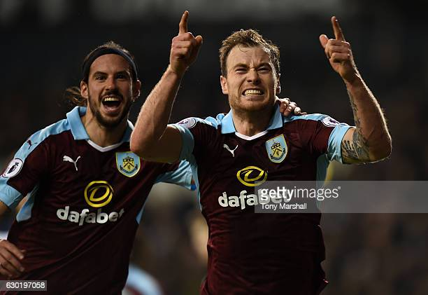 Ashley Barnes of Burnley celebrates scoring his sides first goal with George Boyd of Burnley during the Premier League match between Tottenham...