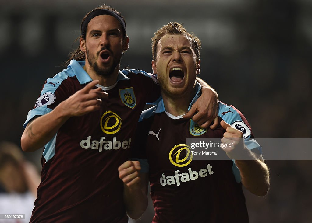 Ashley Barnes of Burnley (R) celebrates scoring his sides first goal with George Boyd of Burnley (L) during the Premier League match between Tottenham Hotspur and Burnley at White Hart Lane on December 18, 2016 in London, England.