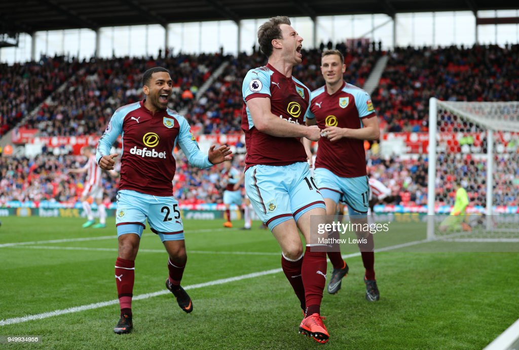 Ashley Barnes of Burnley (C) celebrates scoring his side's first goal with Aaron Lennon (L) and Chris Wood (R) during the Premier League match between Stoke City and Burnley at Bet365 Stadium on April 22, 2018 in Stoke on Trent, England.