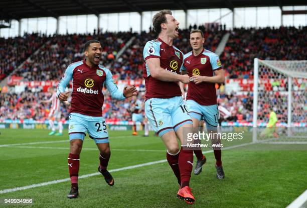 Ashley Barnes of Burnley celebrates scoring his side's first goal with Aaron Lennon and Chris Wood during the Premier League match between Stoke City...