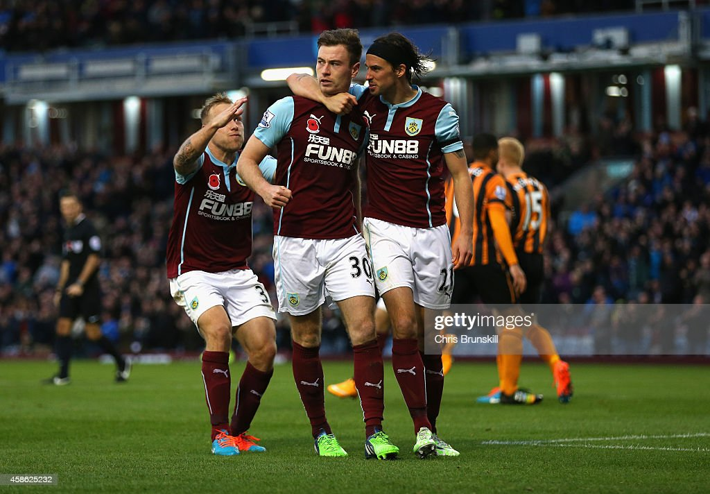 Ashley Barnes of Burnley (C) celebrates scoring the opening goal with team mates during the Barclays Premier League match between Burnley and Hull City at Turf Moor on November 8, 2014 in Burnley, England.