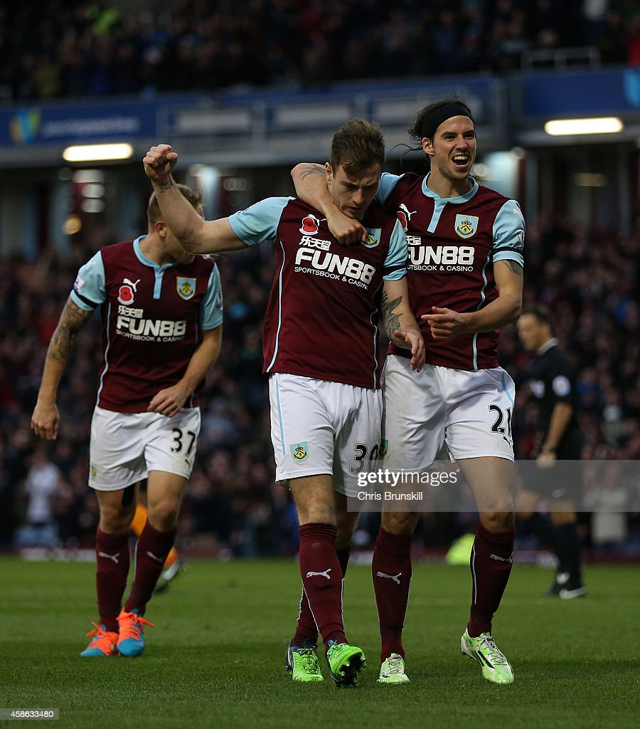 Ashley Barnes (C) of Burnley celebrates scoring the opening goal with team-mate George Boyd during the Barclays Premier League match between Burnley and Hull City at Turf Moor on November 08, 2014 in Burnley, England.