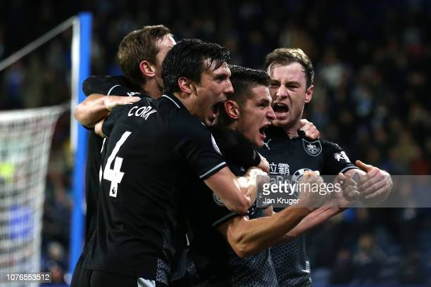 Ashley Barnes of Burnley celebrates with team mates after scoring his sides second goal during the Premier League match between Huddersfield Town and...