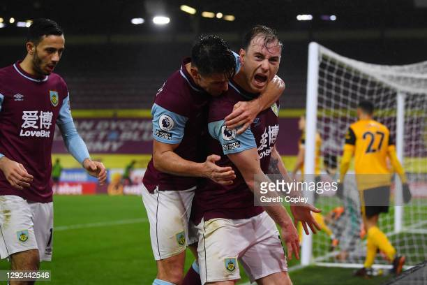 Ashley Barnes of Burnley celebrates with teammate Ashley Westwood after scoring their team's first goal during the Premier League match between...